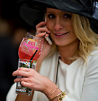 LOUISVILLE, KY - MAY 05: A woman holds both an Oaks Lily and Mint Julep on Kentucky Oaks Day at Churchill Downs on May 5, 2017 in Louisville, Kentucky. (Photo by Scott Serio/Eclipse Sportswire/Getty Images)