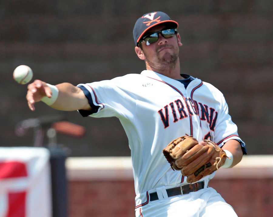 Virginia infielder Branden Cogswell (7) throws to first base in the seventh inning of an NCAA college baseball tournament super regional game against Maryland in Charlottesville, Va., Saturday, June 7, 2014. Maryland defeated Virginia 5-4. (AP Photo/Andrew Shurtleff)
