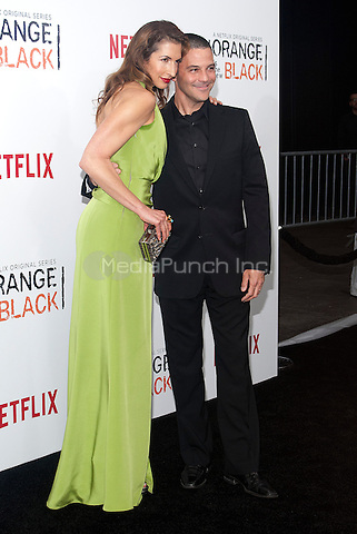 NEW YORK, NEW YORK - MAY 15, 2014:  Actress Alysia Reiner of 'Orange is the New Black', left, and David Alan Basche attend the Season 2 Premiere of 'Orange is the New Black' hosted by Netflix at The Ziegfeld Theater in New York, New York on Thursday May 15, 2014. Photo credit:RTNHargrove/MediaPunch