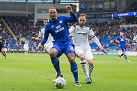 Kenneth Zohore of Cardiff City shoeds the ball from Richard Keogh of Derby County during the Sky Bet Championship match between Cardiff City and Derby County at Cardiff City Stadium, Cardiff, Wales on 30 September 2017. Photo by Mark  Hawkins / PRiME Media Images.