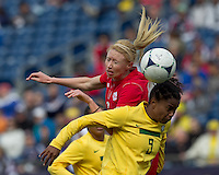 Canadian player Melanie Booth (3) and Brazilian midfielder Renata Costa (9) battle for head ball. In an international friendly, Canada defeated Brasil, 2-1, at Gillette Stadium on March 24, 2012.