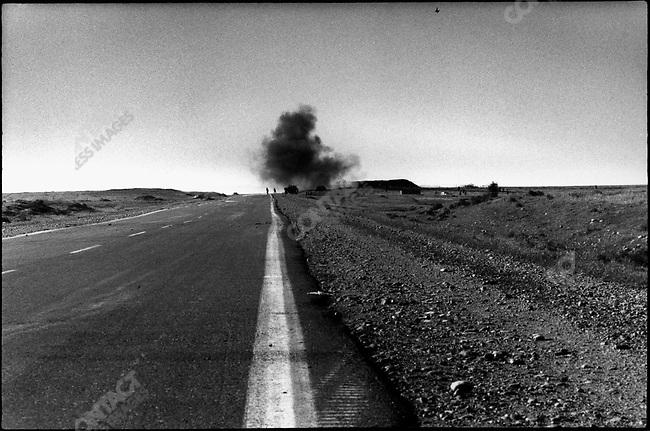 Iraqi tank shell exploding on a kurdish position, road to Arbile, Northern Iraq, 1991
