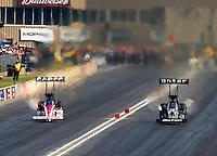 Jul. 19, 2014; Morrison, CO, USA; NHRA top fuel driver Steve Torrence (left) races alongside Shawn Langdon during qualifying for the Mile High Nationals at Bandimere Speedway. Mandatory Credit: Mark J. Rebilas-
