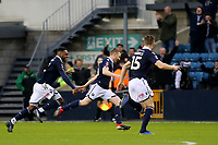 Shane Ferguson (middle) celebrates scoring Millwall's second goal during Millwall vs Hull City, Emirates FA Cup Football at The Den on 6th January 2019