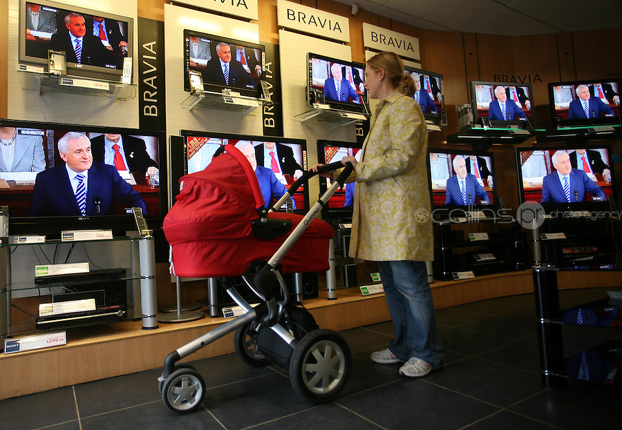 30/04/2008.An Taoiseach Bertie Ahern TD addressing  a joint meeting of the US Houses of Congress on television watched by Catherine Gilmore & her son James Gilmore (9 weeks) both from Sandymount at The Sony Centre on St. Stephens Green, Dublin..Photo: Gareth Chaney Collins