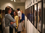 Supporters view the Always Lost: A Meditation on War exhibit at a final reception at Western Nevada College in Carson City, Nev., on Thursday, July 28, 2016. <br />