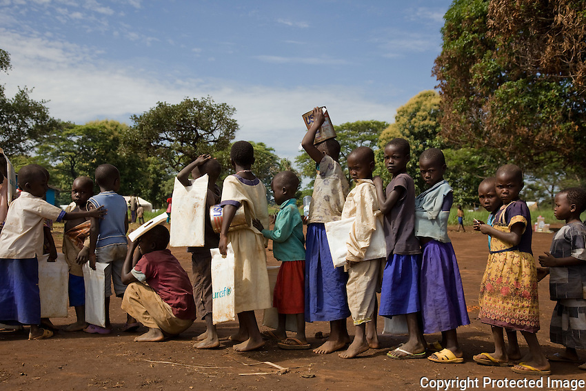 Congolese refugee children wait in line to be screened for sleeping sickness in Nyori refugee camp in South Sudan. The children fled with their families after attacks by  the LRA in the Congo.