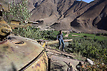 A local boy plays on the turret of a rusting Soviet tank in Afghanistan's Panjsher Valley where life continues on amidst the upheavals of the recent elections and the endless war against the Taliban by the International Coalition. The scars of previous conflicts in the form of rusting , derelict Soviet tanks are a reminder that the local people do not give in easily. Posters of slain leader Ahmed Shah Massoud, the Lion of Panjsher, abound.  Massoud was the most moderate and popular of the anti-Soviet resistance leaders..Following the withdrawal of Soviet troops from Afghanistan and the subsequent collapse of the Soviet-backed government there, Massoud became Defense Minister in 1992 under former Afghan President Burhanuddin Rabbani. Following the collapse of Rabbani's government and the rise of the Taliban in 1996, Massoud returned to the role of an armed opposition leader, serving as the military commander of the United Islamic Front for the Salvation of Afghanistan..On September 9, 2001, two days prior to the September 11 attacks in the United States, Massoud was assassinated in Takhar Province of Afghanistan by suspected al-Qaeda agents.Burqua clad women walk the dusty streets in Afghanistan's Panjsher Valley where life continues on amidst the upheavals of the recent elections and the endless war against the Taliban by the International Coalition. The scars of previous conflicts in the form of rusting , derelict Soviet tanks are a reminder that the local people do not give in easily. Posters of slain leader Ahmed Shah Massoud, the Lion of Panjsher, abound.  Massoud was the most moderate and popular of the anti-Soviet resistance leaders..Following the withdrawal of Soviet troops from Afghanistan and the subsequent collapse of the Soviet-backed government there, Massoud became Defense Minister in 1992 under former Afghan President Burhanuddin Rabbani. Following the collapse of Rabbani's government and the rise of the Taliban in 1996, Massoud returned to the role of