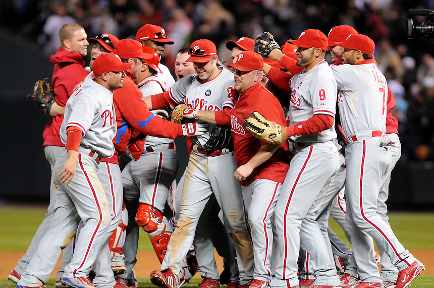 12 October 2009: The Philadelphia Phillies celebrate a series win with a dogpile of closer Brad Lidge during a National League Division Series game between the Philadelphia Phillies and the Colorado Rockies at Coors Field in Denver, Colorado. The Phillies beat the Rockies 5-4 and won the series 3-1. Pictured, among others, are Shane Victorino, Ryan Howard, Chase Utley, Matt Stairs, and Pedro Feliz.  *****For editorial use only*****