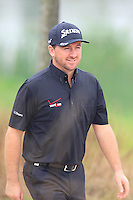 Graeme McDowell (NIR) sinks his putt on the 11th green during Friday's Round 2 of the 2014 BMW Masters held at Lake Malaren, Shanghai, China 31st October 2014.<br /> Picture: Eoin Clarke www.golffile.ie