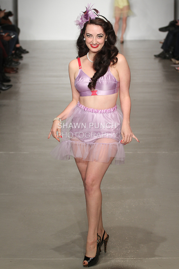Model walks runway in lingerie from the Secrets In Lace collection, during LingerieFW Spring Summer 2015.