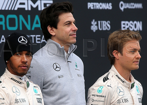 22.02.2016. Barcelona, Spain.  German Formula One driver Nico Rosberg (R) and British Formula One Lewis Hamilton (L) of Mercedes AMG Petronas Team and Austrian Mercedes motor sport boss Torger Christian Toto Wolff (C) are seen during the launch of the new car W07 for the upcoming Formula One season at the Circuit de Barcelona - Catalunya in Barcelona, Spain.
