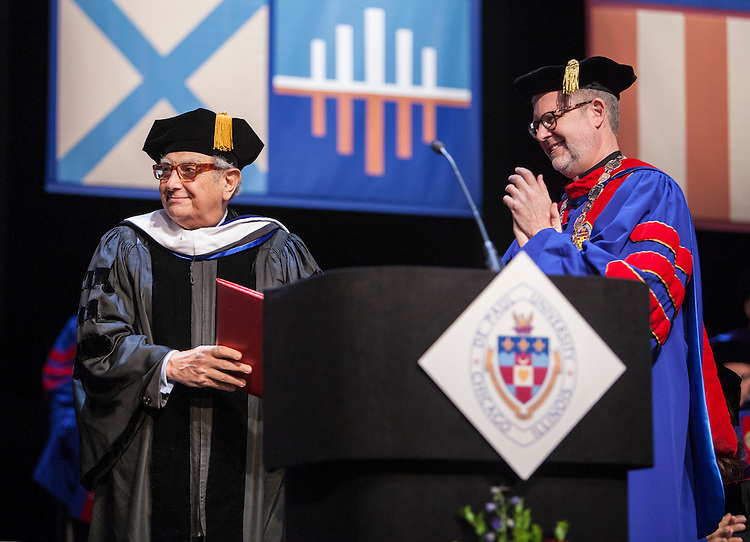 M. Cherif Bassiouni, DePaul emeritus professor of law, is presented with an honorary degree as the DePaul University College of Law held its commencement ceremony on May 17, 2015 at the Rosemont Theatre in Rosemont, IL, where some 280 students received their Juris Doctors or Master of Laws degrees. The Rev. Dennis H. Holtschneider, C.M., president of DePaul, conferred the degrees. (DePaul University/Jeff Carrion)