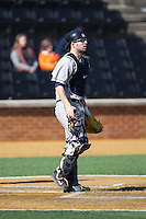 Georgetown Hoyas catcher Eric Webber (21) on defense against the Bucknell Bison at Wake Forest Baseball Park on February 14, 2015 in Winston-Salem, North Carolina.  The Hoyas defeated the Bison 8-5.  (Brian Westerholt/Four Seam Images)