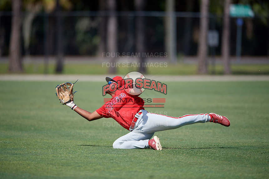 Philadelphia Phillies right fielder Marcus Lee Sang (9) attempts to catch a fly ball during an Instructional League game against the Detroit Tigers on September 19, 2019 at Tigertown in Lakeland, Florida.  (Mike Janes/Four Seam Images)