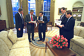 United States President George W. Bush prepares his State of the Union speech with Dan Bartlett, White House Communications Director, at left,  Mike Gerson, director of Presidential Speechwriting, and speech writers Matthew Scully and John McConnell in the Oval Office of the White House in Washington, DC on Thursday, January 23, 2003. <br />