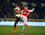 Gabriel Paulista of Arsenal clears as Adama Diomande of Hull City closes in - English FA Cup - Hull City vs Arsenal - The KC Stadium - Hull - England - 8th March 2016 - Picture Simon Bellis/Sportimage