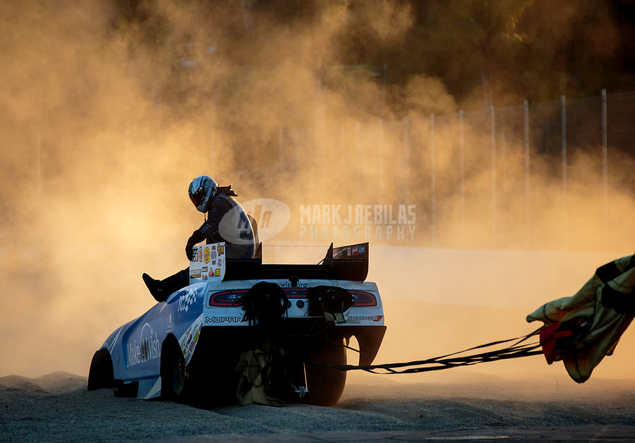 Nov 11, 2018; Pomona, CA, USA; Dust flies as NHRA funny car driver Tommy Johnson Jr goes into the sand trap during the Auto Club Finals at Auto Club Raceway. Mandatory Credit: Mark J. Rebilas-USA TODAY Sports