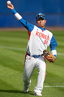 14 September 2009: Shortstop Boung-Gon Jeung of South Korea throws the ball during the 2009 Baseball World Cup Group F second round match game won 15-5 by South Korea over Great Britain, in the Dutch city of Amsterdan, Netherlands.
