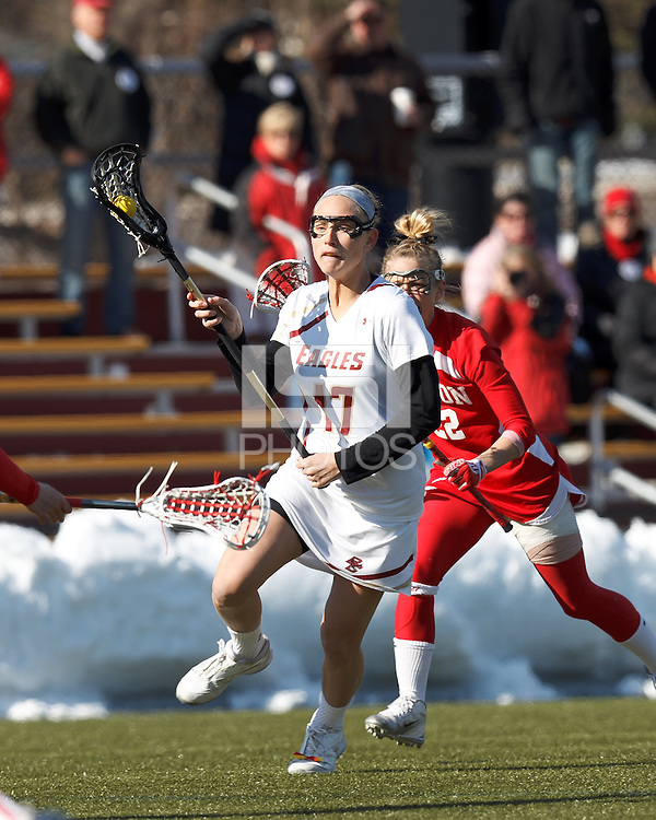 Boston College midfielder Mikaela Rix (17) brings the ball forward. .Boston College (white) defeated Boston University (red), 12-9, on the Newton Campus Lacrosse Field at Boston College, on March 20, 2013.