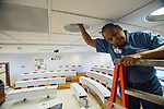 Gwen Hutchins of Facilities Management gets some general maintenance done while the classrooms are empty.   Photo by Kevin Bain/University Communications Photography