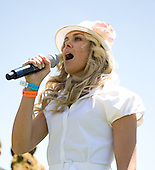 Country singer Laura Bell Bundy belts out the national anthem at Percy Warner Park.