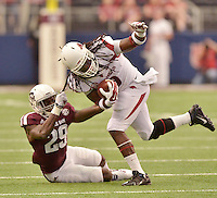 STAFF PHOTO BEN GOFF  @NWABenGoff -- 09/27/14 Texas A&M cornerback Deshazor Everett tackles Arkansas running back Alex Collins by the hair during the first quarter of the Southwest Classic in AT&T Stadium in Arlington, Texas on Saturday September 27, 2014.