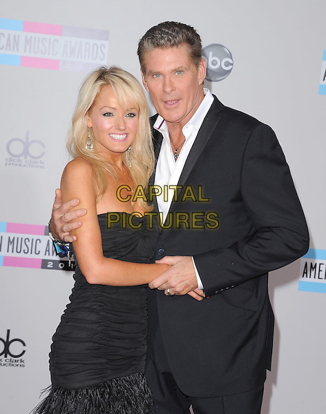 Hayley Roberts & David Hasselhoff .2011 American Music Awards held at The Nokia Theater Live in Los Angeles, California, USA..November 20th, 2011.ama amas ama's half length dress strapless suit white shirt  holding hands  couple black ruched .CAP/RKE/DVS.©DVS/RockinExposures/Capital Pictures.