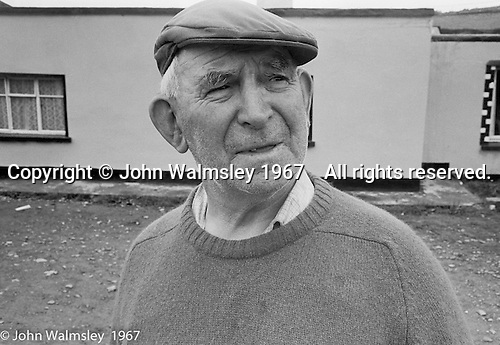 "Local man outside the Inn, Dunquin (in Gaelic, Dún Chaoin, meaning ""Caon's stronghold""), on the tip of the Dingle Peninsula, County Kerry, Ireland.  1971."