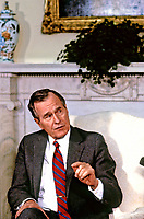 ***FILE PHOTO*** George H.W. Bush Has Passed Away<br /> United States President George H.W. Bush speaks to the press pool in the Oval Office of the White House in Washington, D.C. during his first full day as President on January 21, 1989. CAP/MPI/RS<br /> &copy;RS/MPI/Capital Pictures