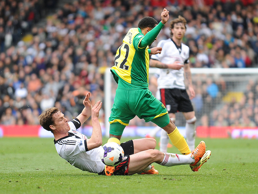 Norwich City's Nathan Redmond is tackled by Fulham's Scott Parker<br /> <br /> Photo by Ashley Western/CameraSport<br /> <br /> Football - Barclays Premiership - Fulham v Norwich City - Saturday 12th April 2014 - Craven Cottage - London<br /> <br /> &copy; CameraSport - 43 Linden Ave. Countesthorpe. Leicester. England. LE8 5PG - Tel: +44 (0) 116 277 4147 - admin@camerasport.com - www.camerasport.com