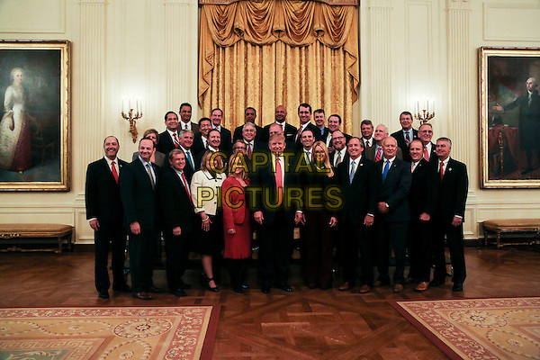 United States President Donald Trump poses with the National Association of Attorneys General in the State Dining Room of the White House, Washington, DC, February 28, 2017. <br /> CAP/MPI/CNP/RS<br /> &copy;RS/CNP/MPI/Capital Pictures