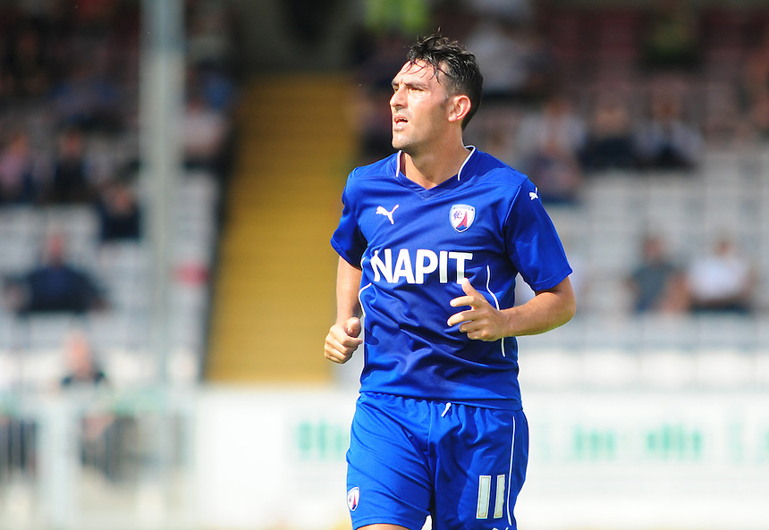 Chesterfield's Gary Roberts<br /> <br /> Photographer Chris Vaughan/CameraSport<br /> <br /> Football - Friendly - Lincoln City v Chesterfield - Saturday 19th July 2014 - Sincil Bank Stadium - Lincoln<br /> <br /> &copy; CameraSport - 43 Linden Ave. Countesthorpe. Leicester. England. LE8 5PG - Tel: +44 (0) 116 277 4147 - admin@camerasport.com - www.camerasport.com
