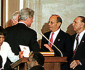Washington, DC - September 23, 1998 -- United States President Bill Clinton and United States Senator Alfonso D'Amato (Republican of New York) share some thoughts following President Nelson Mandela's speech accepting the Congressional Gold Medal in The United States Capitol Rotunda on Wednesday, September 23, 1998...Credit: Ron Sachs / CNP