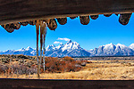 Icicles hang from the roof of the old Cunningham Cabin outside Jackson Hole, Wyoming.  The Teton Mountain Range can be seen through the opening in the building,