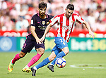 Sporting de Gijon's Moi Gomez (r) and FC Barcelona's Andre Gomes during La Liga match. September 24,2016. (ALTERPHOTOS/Acero)