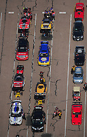 Apr. 28, 2012; Baytown, TX, USA: Aerial view of NHRA funny car drivers in the staging lanes during qualifying for the Spring Nationals at Royal Purple Raceway. Mandatory Credit: Mark J. Rebilas-