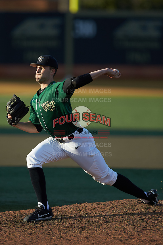 Wake Forest Demon Deacons relief pitcher Tyler Witt (12) in action against the Louisville Cardinals at David F. Couch Ballpark on March 17, 2018 in  Winston-Salem, North Carolina.  The Cardinals defeated the Demon Deacons 11-6.  (Brian Westerholt/Four Seam Images)