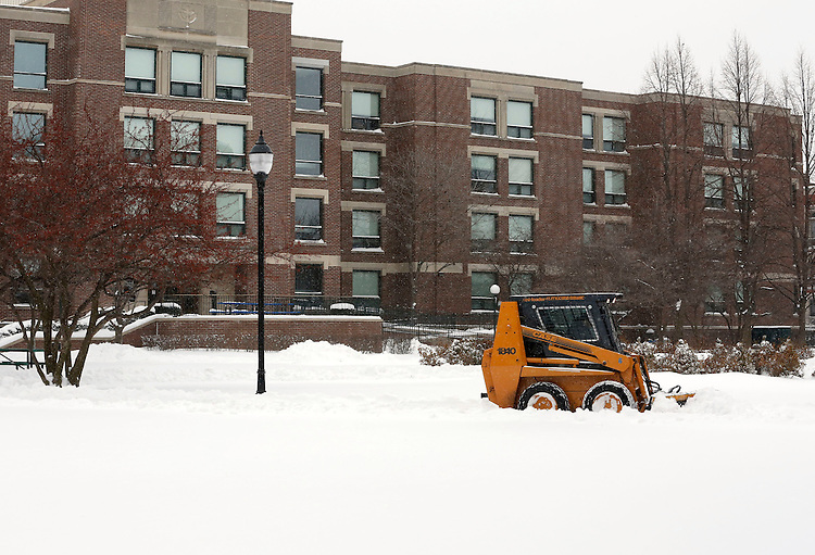 Crews plow through sidewalks of snow on the Lincoln Park campus of DePaul University in Chicago as the New Year brought two days of lake effect snow and ice. (Photo by Jamie Moncrief)