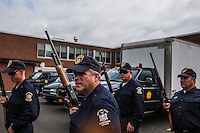 Corrections officers part of CERT, Corrections Emergency response Team,  muster for a search of the areas in and around Frienship, NY. Brendan Bannon. June 21, 2015