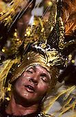 Rio de Janeiro, Brazil. Carnival; samba school; sweating ecstatic man wearing a gold headdress.