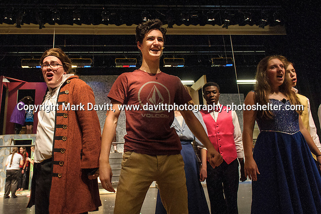 Dakota Skinner as Lefou and Gavin Runles as Gaston rehearse for Southeast Polk High School's Beauty and the Beast to be presented Nov. 11 at 7 p.m. and Nov. 12 at 7 p.m. In addition, on Nov. 12 at 10–11:30 a.m. The players will host a VIP Enchanted Event in which  guests can meet Bell, the Beast, and other characters.