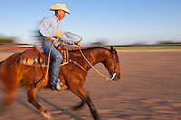 Murray Thompson, World Champion for Reined Cow Horse working his horse in the ring