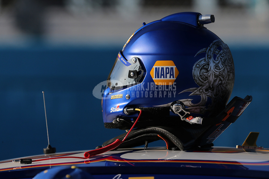 Mar. 1, 2013; Avondale, AZ, USA; Detailed view of the helmet and hans device of NASCAR Sprint Cup Series driver Martin Truex Jr during qualifying for the Subway Fresh Fit 500 at Phoenix International Raceway. Mandatory Credit: Mark J. Rebilas-