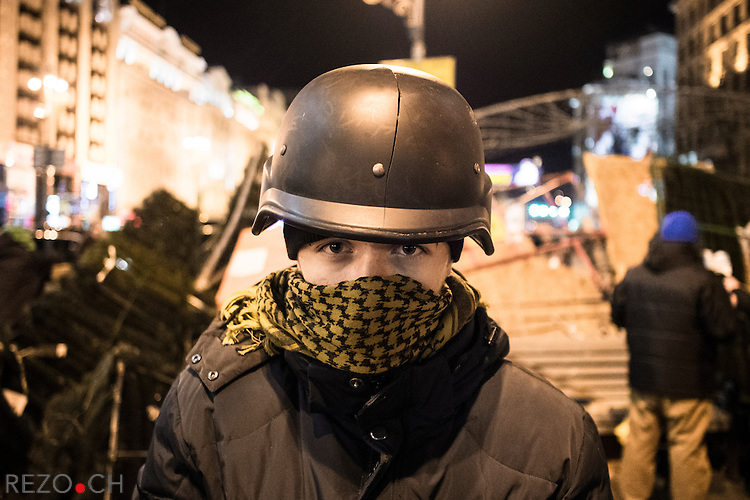 Kiev, Ukraine - 03 december 2013: Illya, 13 years old volunteered to guard one of the barricade blocking the potential police offensive against euromaidan. During the violent riot-police attack on maidan on saturday the 30th of november, he got hit by berkut (Ukrainian riot-police) so hard his helmet cracked. Credit: Niels Ackermann / Rezo.ch