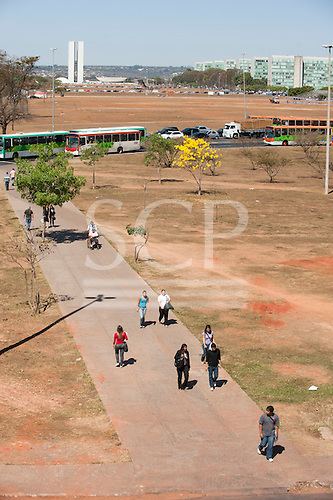 Brasilia, Brazil. People going to work  on path to Ministries and Congress buildings.