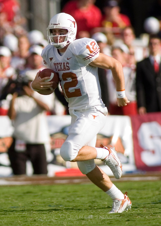 07 October 2006: Texas quarterback Colt McCoy (#12) runs with the ball during the Longhorns 28-10 victory over the University of Oklahoma Sooners at the Cotton Bowl in Dallas, TX.