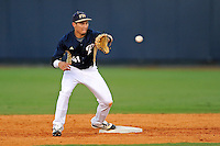 2 March 2012:  FIU infielder Jeremy Bajdaun (41) catches a throw from the catcher during pre-game warm-ups as the FIU Golden Panthers defeated the Brown University Bears, 6-5, at University Park Stadium in Miami, Florida.
