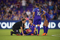 Orlando, FL - Saturday March 24, 2018: Orlando Pride forward Alex Morgan (13) speaks to the trainer after a collision during a regular season National Women's Soccer League (NWSL) match between the Orlando Pride and the Utah Royals FC at Orlando City Stadium. The game ended in a 1-1 draw.