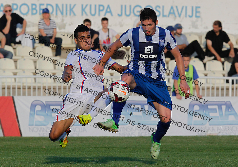 Fudbal Super liga season 2013-2014<br /> Ofk Beograd v Jagodina<br /> Sasa Zdjelar (R) and Mohamed El Monir<br /> Beograd, 09.11.2013.<br /> foto: Srdjan Stevanovic/Starsportphoto &copy;
